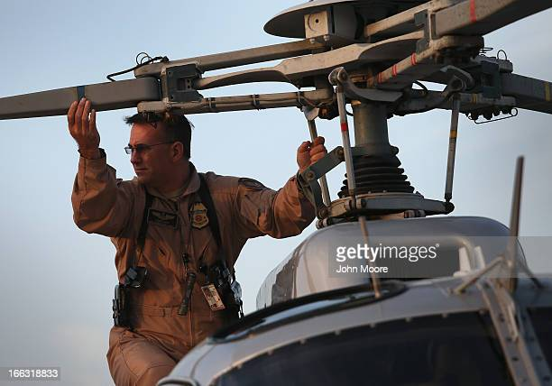 US Office of Air and Marine pilot Rob Smith performs a preflight check on an Astar B2 helicopter before flying a patrol along the USMexico border on...