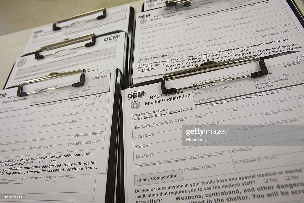 Office of Emergency Management (OEM) hurricane shelter registration forms are stacked up inside a shelter in New York, U.S., on Monday, Oct. 29, 2012. Hurricane Sandy strengthened on its path toward New Jersey, where it is predicted to make landfall today while bringing a life-threatening storm surge as it whips a region of 60 million people with high winds and rain. Photographer: Scott Eells/Bloomberg via Getty Images