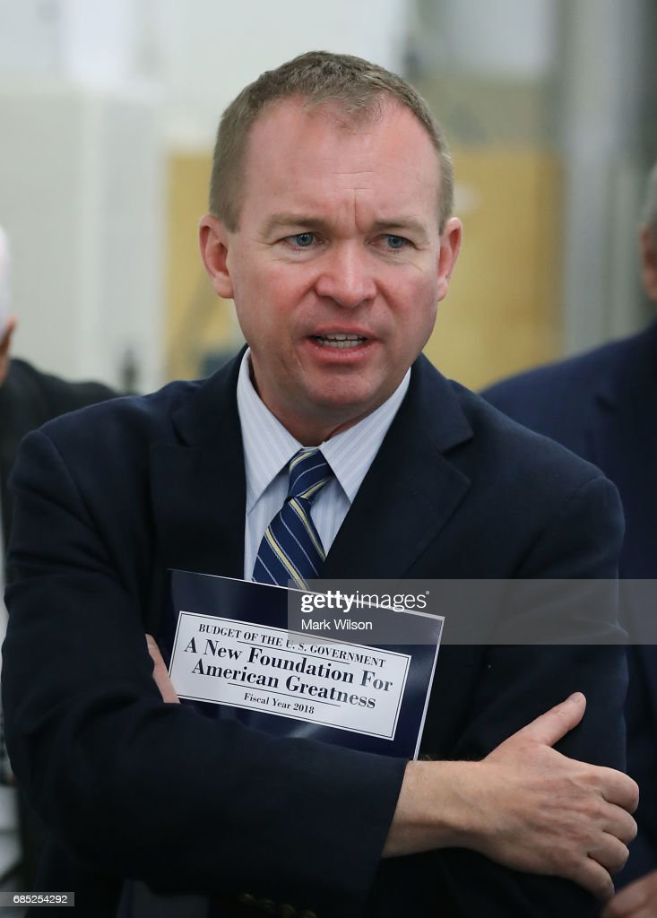 Office of Management and Budget Director Mick Mulvaney, holds a copy of President Trump's FY'18 budget while touring the binding facility at the Government Publishing Office, on May 19, 2017 in Washington, DC.