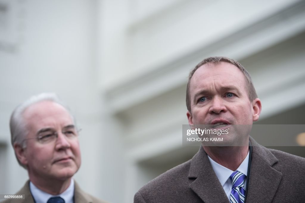 Office of Management and Budget Director Mick Mulvaney (R) speaks to reporters with US Health and Human Services Secretary Tom Price (L) outside the West Wing of the White House in Washington, DC, on March 13, 2017. /