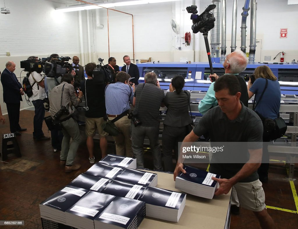 Office of Management and Budget Director Mick Mulvaney, (T-C) tours the binding facility where President Trump's FY'18 budget books are being produced, at the Government Publishing Office, on May 19, 2017 in Washington, DC.