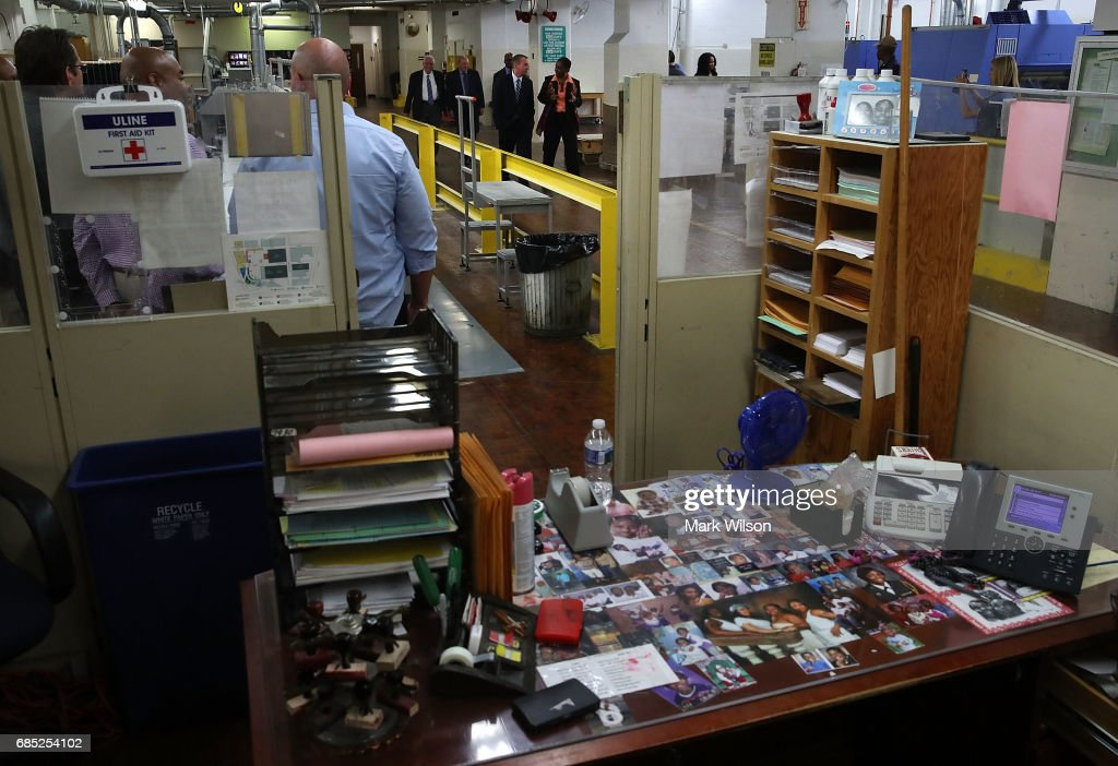 Office of Management and Budget Director Mick Mulvaney, (C), tours the binding facility where President Trump's FY'18 budget books are being produced, at the Government Publishing Office, on May 19, 2017 in Washington, DC.