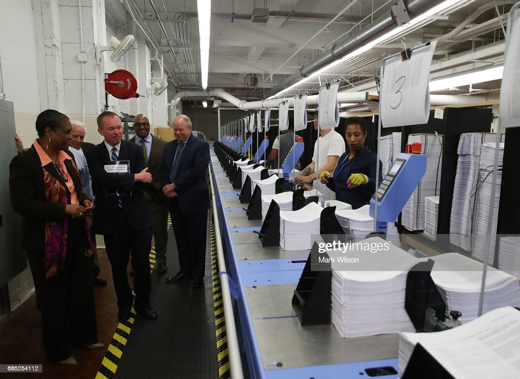 Office of Management and Budget Director Mick Mulvaney, tours the binding facility where President Trump's FY'18 budget books are being produced, at the Government Publishing Office, on May 19, 2017 in Washington, DC.