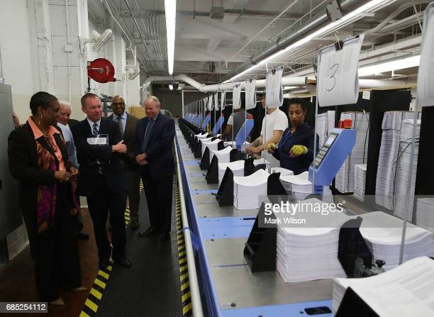 Office of Management and Budget Director Mick Mulvaney tours the binding facility where President Trump's FY'18 budget books are being produced at...