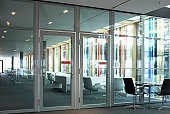 Office park lobby with a row of meeting chairs