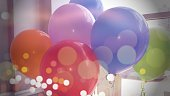 Party balloons in an office setting. Perfect for promoting holiday parties and/or festivities in a business environment.