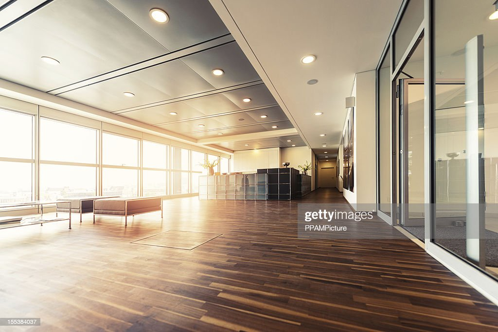 Office reception with wood floors and window wall : Stockfoto