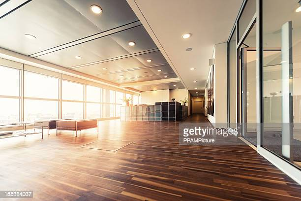 Office reception with wood floors and window wall
