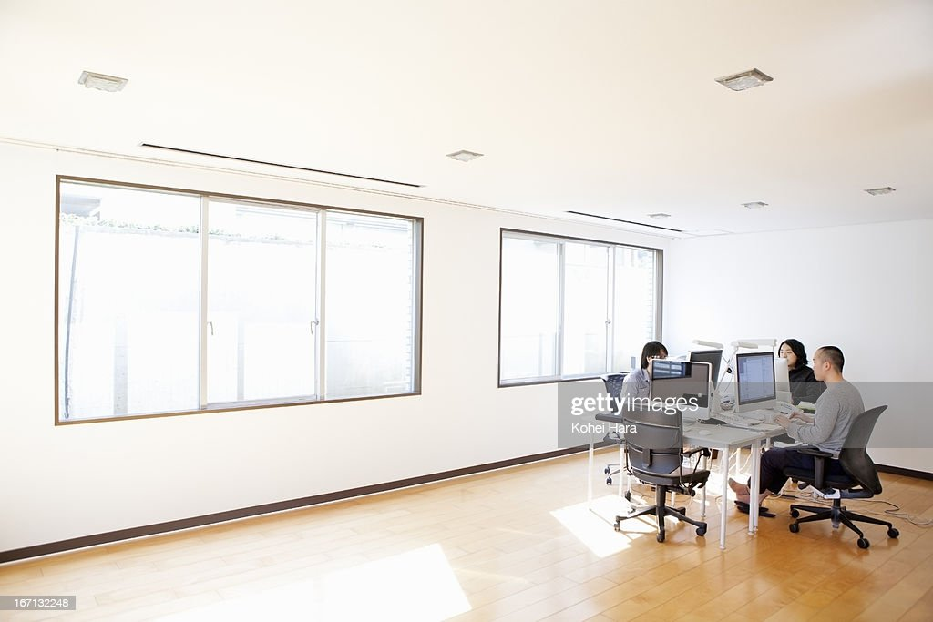 Office space of a web design company stock photo getty for Office space design companies