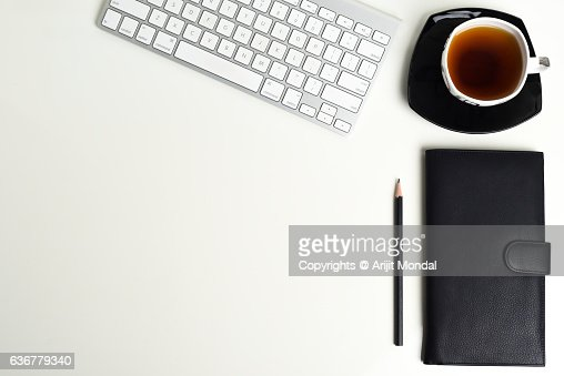 top office table cup. office table top view with black tea cup pen computer