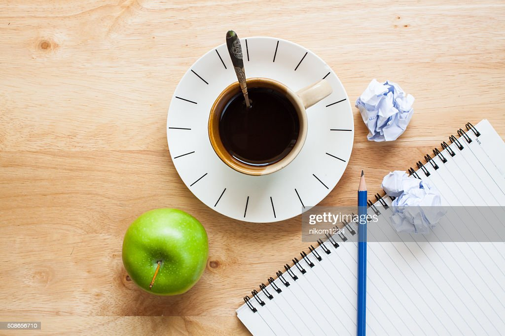 Office table with notepad, computer, coffee cup , computer mouse : Stock Photo