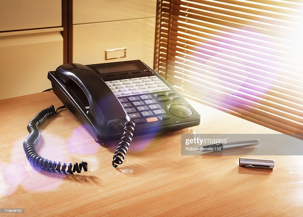 Office telephone with severed cord. : Stock Photo