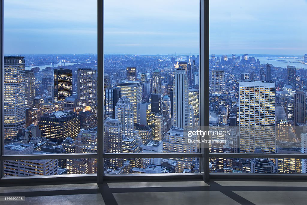 office window over a lit city : Stock Photo