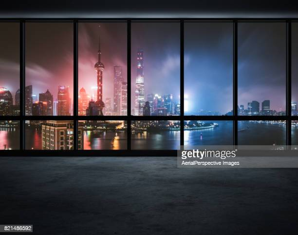 Office Window Over a Lit City