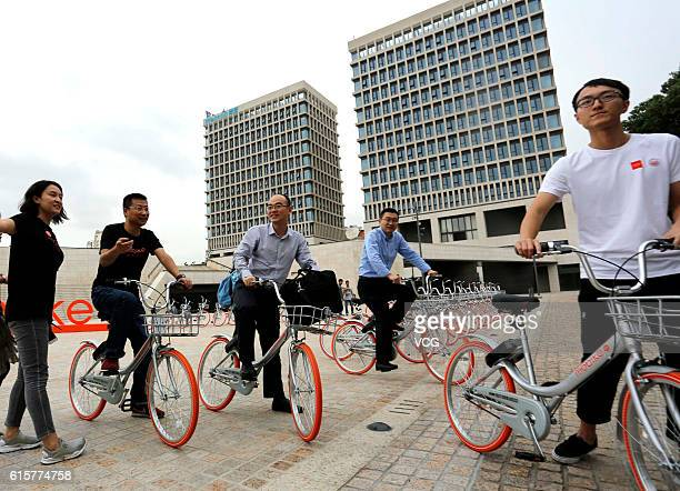 Office wo2rkers experience the Mobike Lite bicybles at Baoshan District on October 19 2016 in Shanghai China The bikesharing service company Mobike...