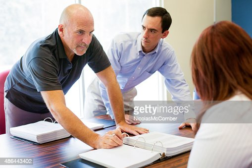 Office worker aggressively makes a point during meeting