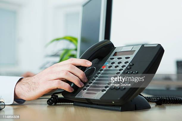 Office worker answering telephone