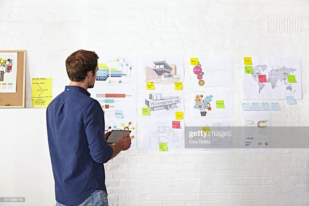 Office worker brainstorming in creative office.