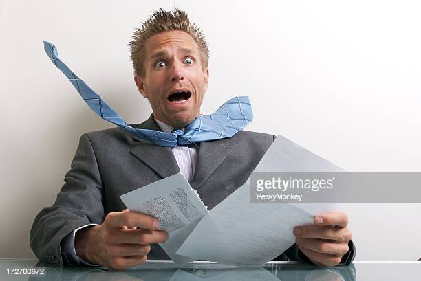 Office Worker Businessman Opening Letter with Expression of Stress
