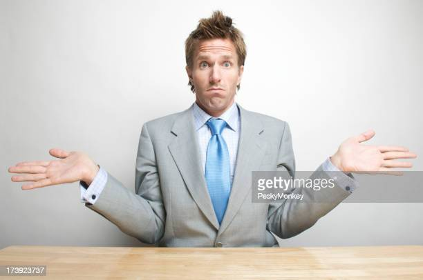 Office Worker Businessman Shrugging in Surprise at Desk