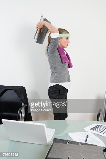 Office worker exercising with ring binder