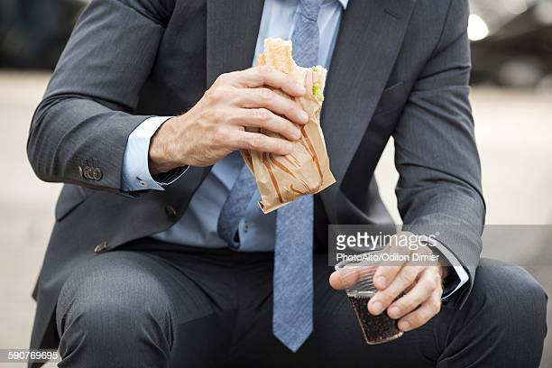 Office worker having lunch outdoors