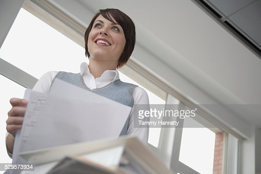 Office worker holding documents : Stock Photo