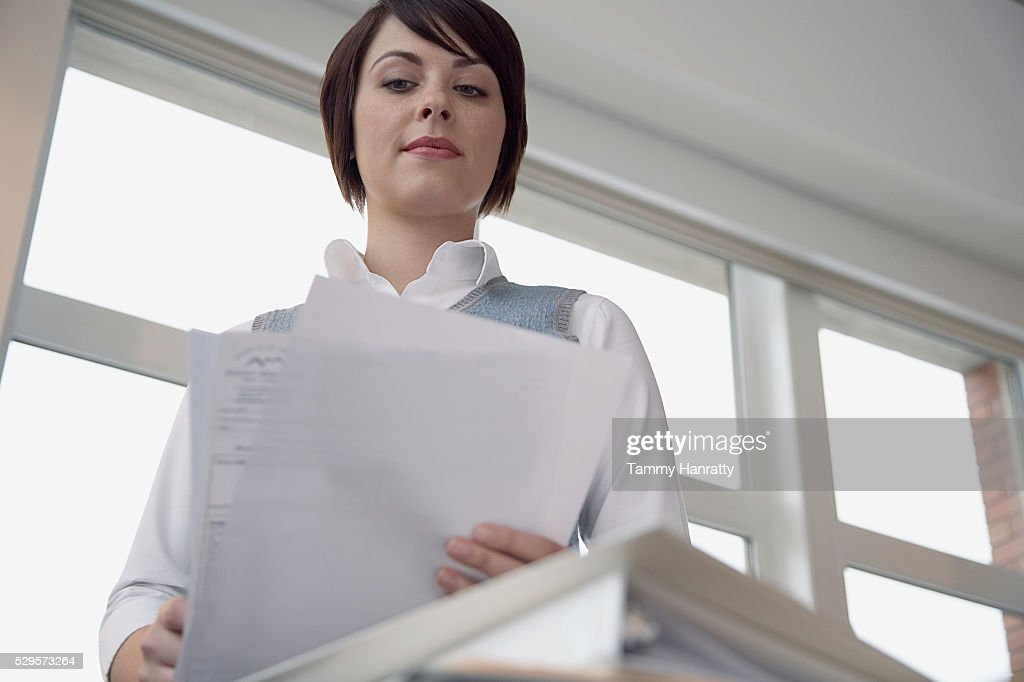 Office worker looking at documents : Stock Photo