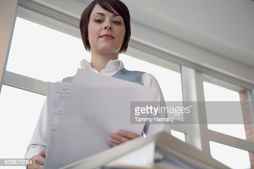 Office worker looking at documents : Foto de stock