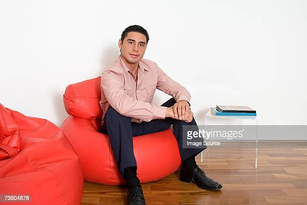 Office worker sitting on a beanbag