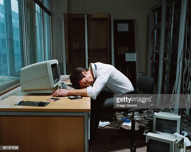 Office worker slumped on his desk