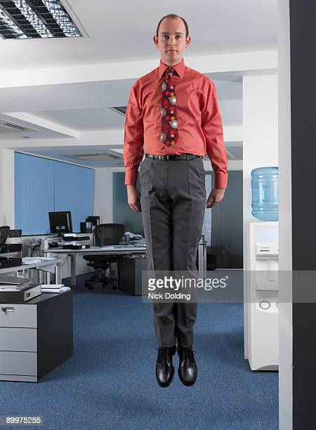 Office worker suspended in mid air