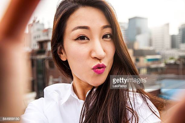 Office worker taking selfie in Seoul downtown