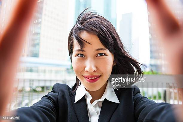 Office worker taking selfie in Tokyo downtown