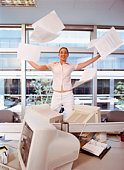 Office worker tossing papers in the air, Buenos Aires, Argentina