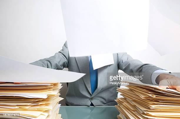 Office Worker Tries to Keep Paperwork Down