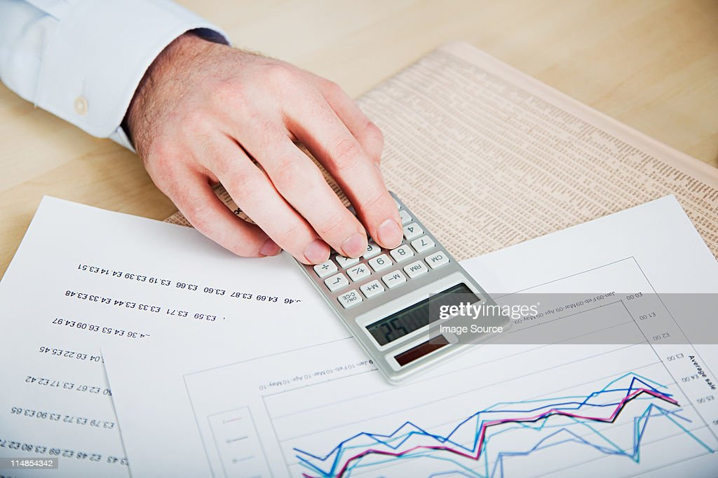 Office worker using calculator