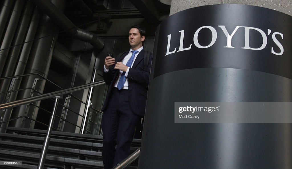 A office worker walks from the Lloyd's Building, the home of the insurance institution Lloyd's of London on September 25 2008 in London, England. Lloyds of London are due to announce their interim results today as US President George Bush calls for the Ameriacn people to support his multi billion dollar rescue plan for the US economy.