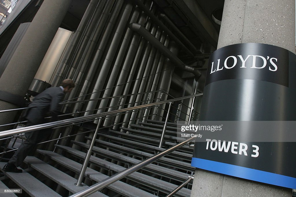 A office worker walks into the Lloyd's Building, the home of the insurance institution Lloyd's of London on September 25 2008 in London, England. Lloyds of London are due to announce their interim results today as US President George Bush calls for the Ameriacn people to support his multi billion dollar rescue plan for the US economy.