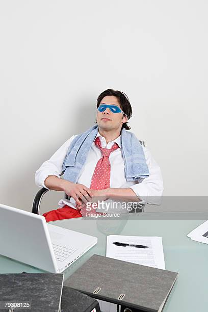 Office worker wearing eye mask