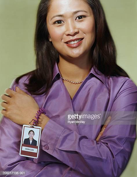 Office worker wearing ID badge around wrist, portrait