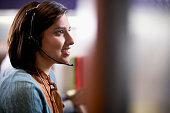 Office Worker Wearing Telephone Headset