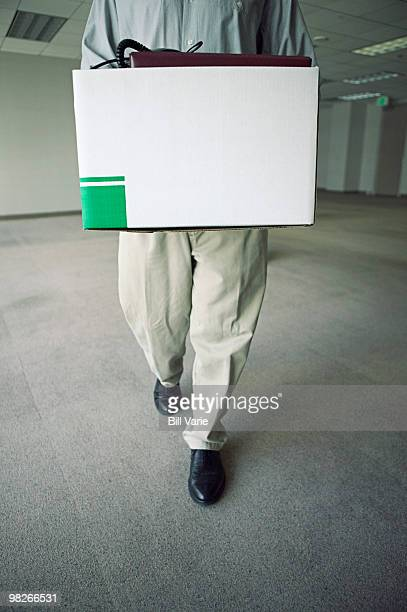 Office worker with box of personal belongings
