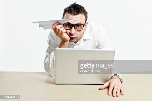 Office worker with laptop and paper plane is boring