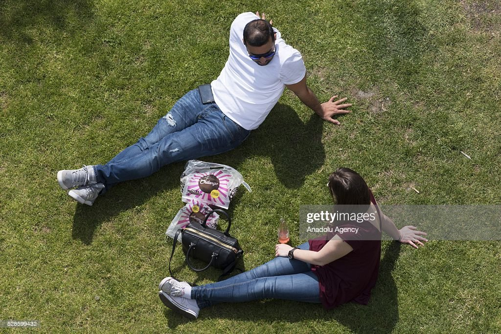 Office workers and visitors sitting in Potters Field public park during lunch hour they enjoying the 23c weather in London, United Kingdom on May 6, 2016.
