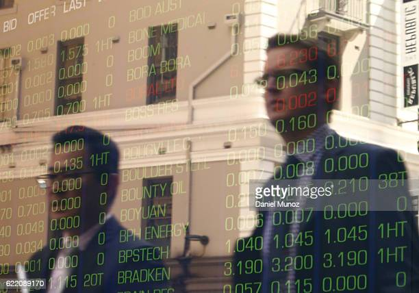 Office workers are reflected on a window of the Australian Securities Exchange building on November 10 2016 in Sydney Australia Americans voted...