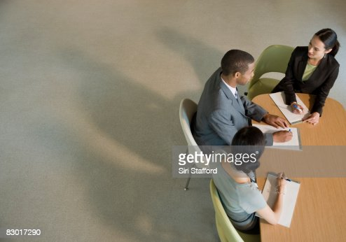 office workers at meeting table : Stock Photo