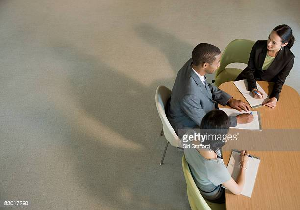 office workers at meeting table