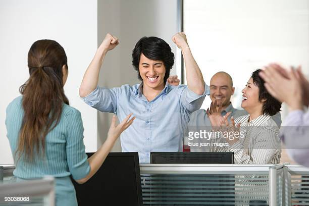 Office workers celebrate a success