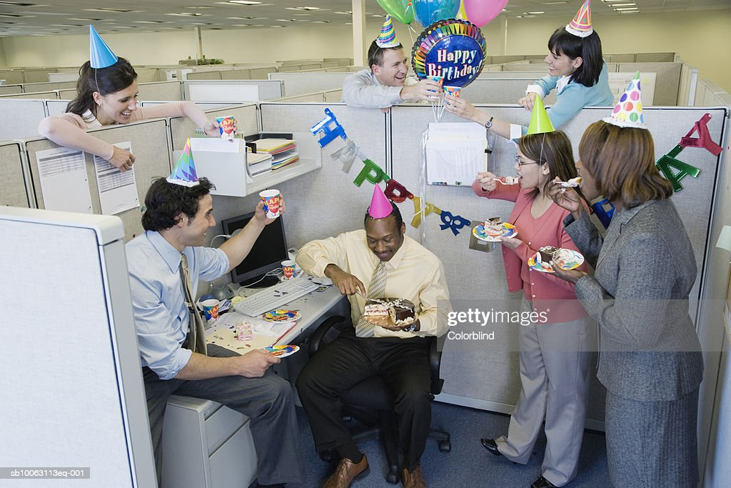 Office workers celebrating birthday party, elevated view